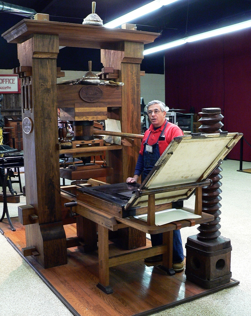 Movable type printing press
