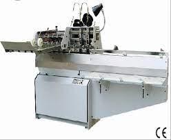 Saddle stitch machine